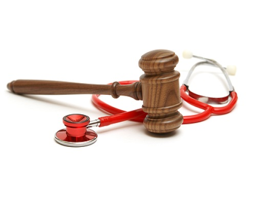 our slider photo about legal health, which depicts a gavel and a stethoscope.